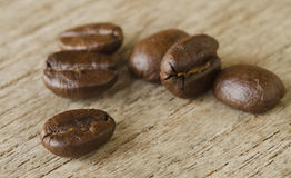 Coffee on wooden background. Coffee beans on wooden background Royalty Free Stock Image
