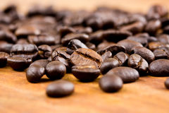 Coffee on wooden background Fresh coffee beans on wood Royalty Free Stock Photo