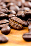Coffee on wooden background Fresh coffee beans on wood Royalty Free Stock Image