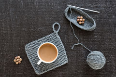 Coffee, wooden beads and crocheting on black Stock Photos