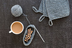 Coffee, wooden beads and crocheting on black Royalty Free Stock Images
