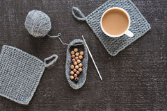 Coffee, wooden beads and crocheting on black Royalty Free Stock Photo