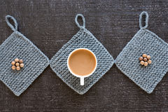 Coffee, wooden beads and knitted props on black Stock Photography