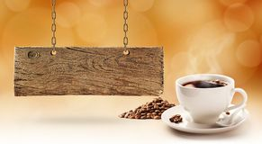 Coffee and wooden board. Good quality coffee and old, wooden signboard Stock Photos