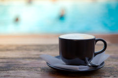 Coffee on wooden deck near Swimming pool Royalty Free Stock Photos
