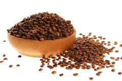 Coffee in a wooden mortar. On the white background. (isolated stock photos