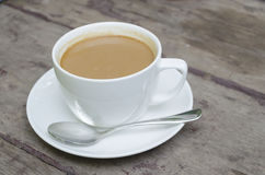 Coffee. On the wooden table Royalty Free Stock Photo