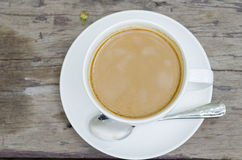 Coffee. On the wooden table Royalty Free Stock Photos