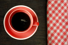 Coffee on wooden table with checked tablecloth Stock Images
