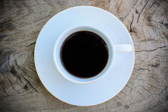 Coffee on wooden table Stock Image