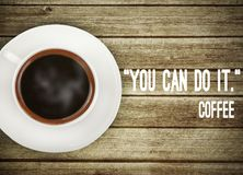 Coffee on wooden table with motivation quote. Fresh coffee on wooden table with motivation quote royalty free stock images