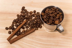 Coffee on wooden top. Coffee beans on wooden board Royalty Free Stock Photos