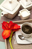 Coffee on wooden tray wit flower composition Royalty Free Stock Image