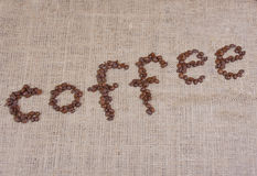 Coffee word with beans Stock Photos