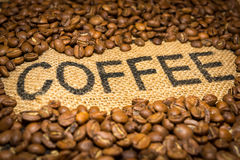 Coffee word and beans Royalty Free Stock Photos