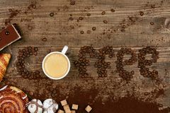 Coffee Word And Beans With Cup Of Coffee. Flat Lay Close Up Of Mug Of Hot Aromatic Beverage, Sweets And Word Making Of Beans On Wooden Table. Top View. High Royalty Free Stock Images