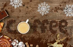 Coffee Word And Beans With Cup Of Coffee. Flat Lay Close Up Of Mug Of Hot Aromatic Beverage, Sweets And Word Making Of Beans On Wooden Table. Top View. High Stock Photos