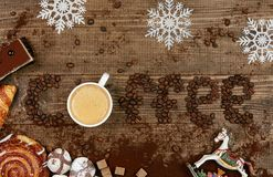 Coffee Word And Beans With Cup Of Coffee. Flat Lay Close Up Of Mug Of Hot Aromatic Beverage, Sweets And Word Making Of Beans On Wooden Table. Top View. High Royalty Free Stock Photo
