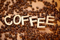 Coffee word with beans Royalty Free Stock Images