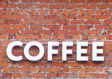 Coffee word in bulk letters on a brick wall royalty free stock photography