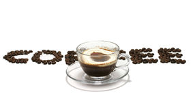 Coffee word with coffee cup. Coffee word typewrited with coffee seeds and coffee cup Stock Photos