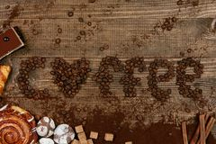 Coffee Word With Heart Of Coffee Beans. Close Up Of Different Sweets And Coffee Beans On Wooden Table. Top View. High Resolution Stock Photo