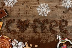 Coffee Word With Heart Of Coffee Beans. Close Up Of Different Sweets And Coffee Beans On Wooden Table. Top View. High Resolution Stock Photos