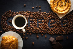 Coffee word made by coffee beans with  chocolate , pastry and cup of coffee Stock Image