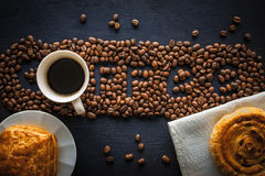 Coffee word made by coffee beans with  pastry and cup of coffee Royalty Free Stock Photography