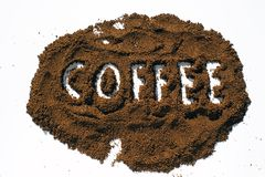 coffee word written in ground coffe Stock Photos
