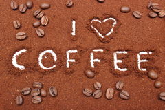 Coffee word written on ground coffee and grains Royalty Free Stock Image