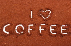 Coffee word written on ground coffee Stock Images