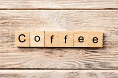 Coffee word written on wood block. coffee text on table, concept stock images