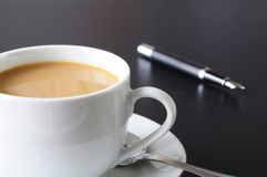 Coffee at work. Or for breakfast in the office Royalty Free Stock Image
