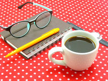 Coffee and work on tablecloth Royalty Free Stock Photos