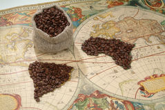 Coffee World. Coffee beans on the world map stock photos