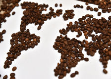Coffee world map. Continents made of coffee beans on white canvas. Background. Low depth of field Stock Image