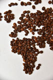 Coffee world map. Continents made of coffee beans on white canvas. Background. Low depth of field. Flat. Africa, Europe, Italy Royalty Free Stock Photo