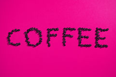 Coffee written with beans on pink Royalty Free Stock Photography