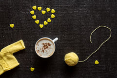 Coffee, yarn and button heart Stock Image