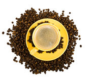 Coffee in yellow cup Stock Images