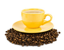 Coffee in yellow cup Stock Photos