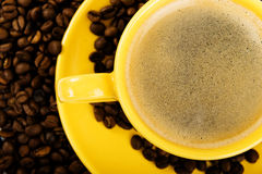 Coffee in yellow cup Royalty Free Stock Image