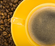 Coffee in yellow cup Royalty Free Stock Photography