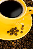 Coffee in yellow cup Royalty Free Stock Photos
