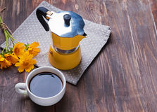 Coffee and yellow flowers Royalty Free Stock Image