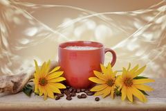 Coffee with yellow flowers on wooden table Royalty Free Stock Photos