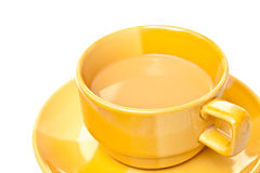 Coffee in yellow glass. Stock Image