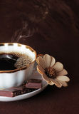 Coffee for you. The cup of coffee with chocolate on brown background stock photography