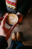 Coffee for you with love. Someone gives another person a cup of hot drink stock photo